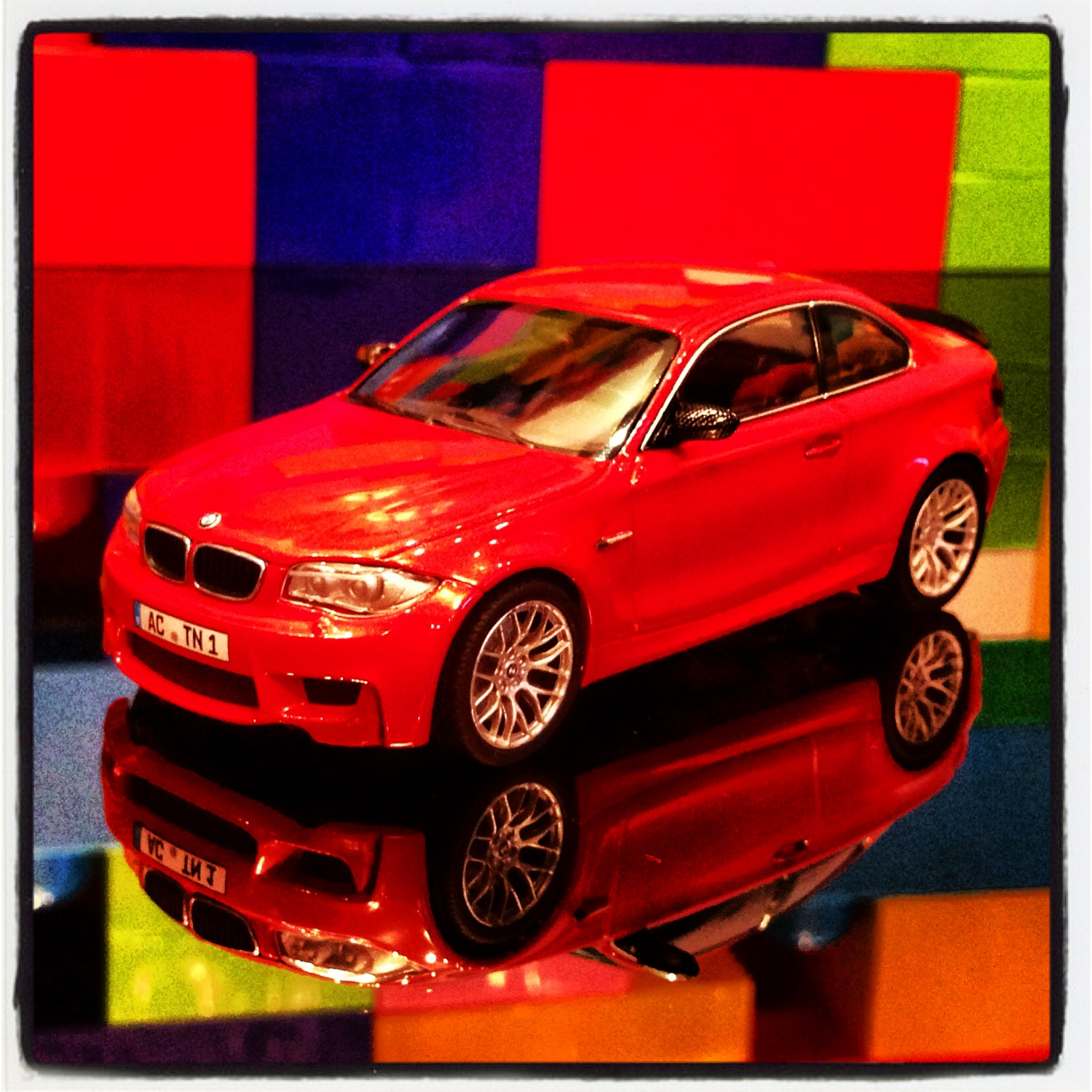 BMW 1M coupe (E82) red with black spoiler (minichamps)